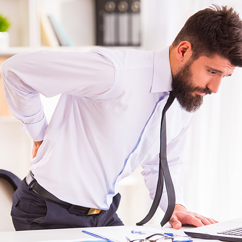 man with back pain needing chiropractic care